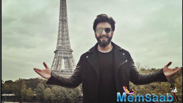 Here He was spotted outside the iconic Eiffel Tower posing as he makes ready to set up the trailer tonight.