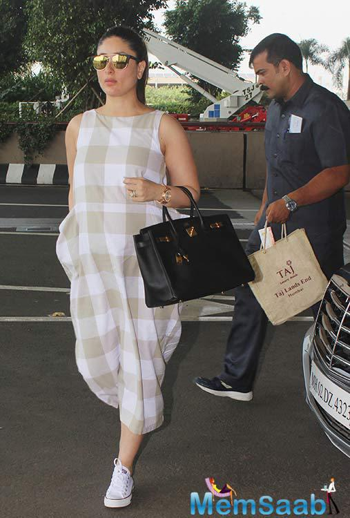 Bebo is in her final trimester of pregnancy as the royal couple is expecting to deliver the baby in December. Kareena was seen wearing a loose checkered outfit which she styled with lovely sunglasses and neatly tied back hair.