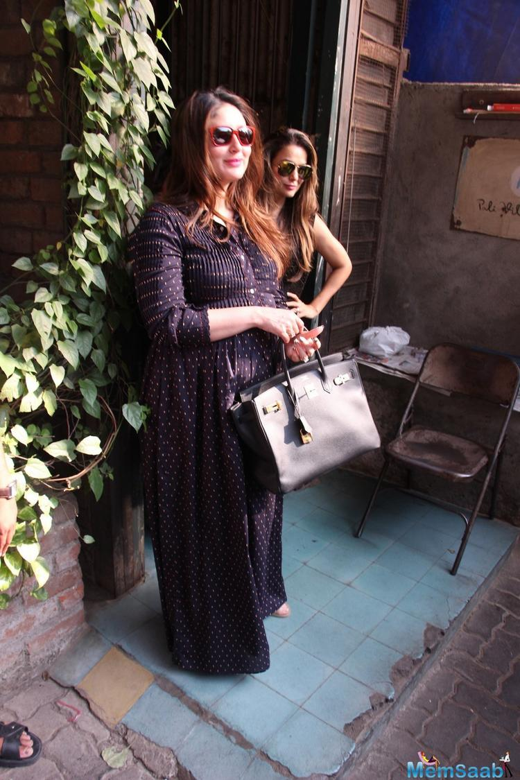 She looked very stunning with this maxi dress, The actress was spotted with her BFF Amrita Arora and sister Karisma Kapoor.