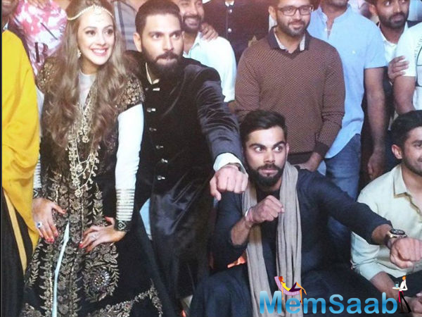 Virat is seen enjoying the party, but where is Anushka.