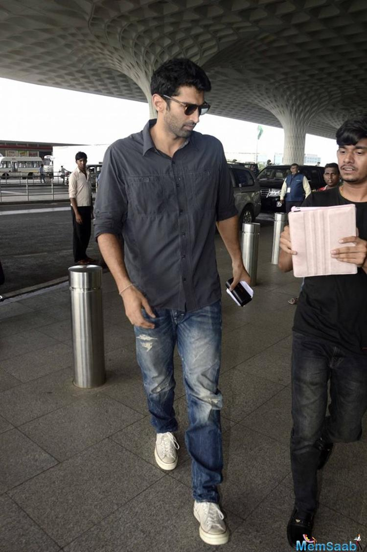 The Fitoor star sported a stubble and completed his look with wayfarer style sunglasses along with a pair of white sneakers.
