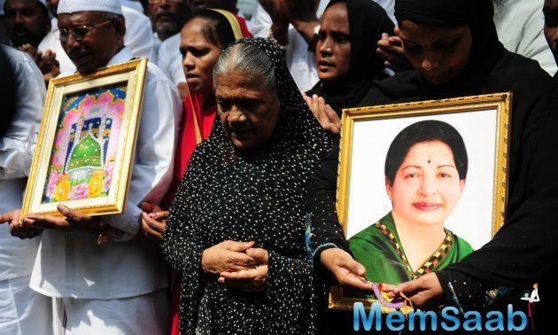 Supporters of Tamil Nadu Chief Minister Jayalalitha Jayaram pray for her wellbeing outside the hospital where she is being treated.