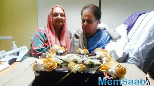 Dilip also shared a photograph of himself along with his wife and veteran actress Saira Banu cutting a chocolate cake in the hospital.