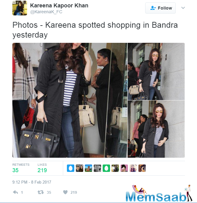 The stunning mommy sported a long black jacket over a striped top and fitted blue denim.