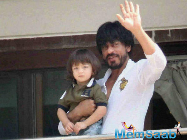 The onlookers naturally couldn't contain their excitement at the vision of King Khan and his son.