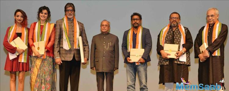 The president felicitates Bachchan as Shoojit and the film's director Aniruddha Roy Chaudhary clap