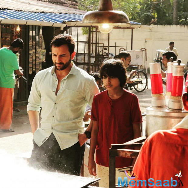 Now the first look from the movie is out. In the still, we can see Saif having a nice coversation with Svar Kamble who plays the role of his son in the movie.