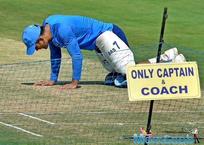 Dhoni was seen having a discussion with the curator as he threw a look at the preparations for the crucial game.