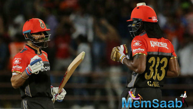 Chris Gayle and Virat Kohli turned up the fireworks on Tuesday night in Rajkot, as Royal Challengers Bangalore ran away with a 21-run win at the Saurashtra Cricket Association Stadium.
