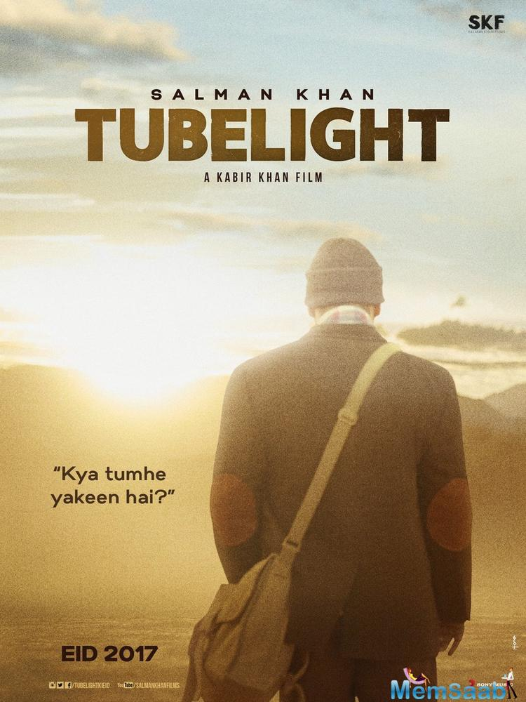 The poster shows Salman Khan back facing, sporting a winter cap. The poster's caption reads 'Kya Tumhe Yakeen Hai?'.