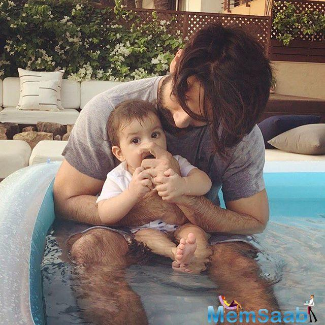 Shahid Kapoor has shared a lovely photograph of himself along with his daughter Misha enjoying some time in the pool.