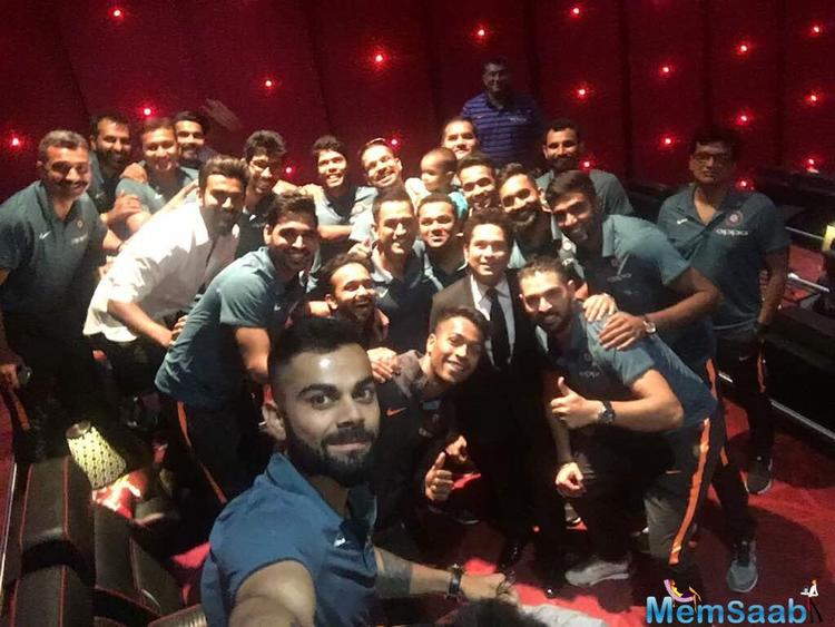 Virat Kohli clicks a selfie with Sachin Tendulkar Team India's Champions Trophy squad, at the 'Sachin: A billion dreams' premier.