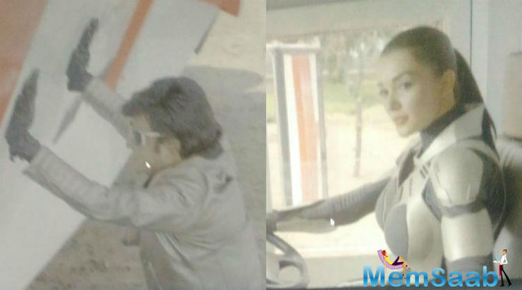 In the leaked pictures, Rajnikanth as Chitti is seen boosting up a truck while Amy, on the other hand, is seen in a white robot-like suit sitting in the driver's seat.