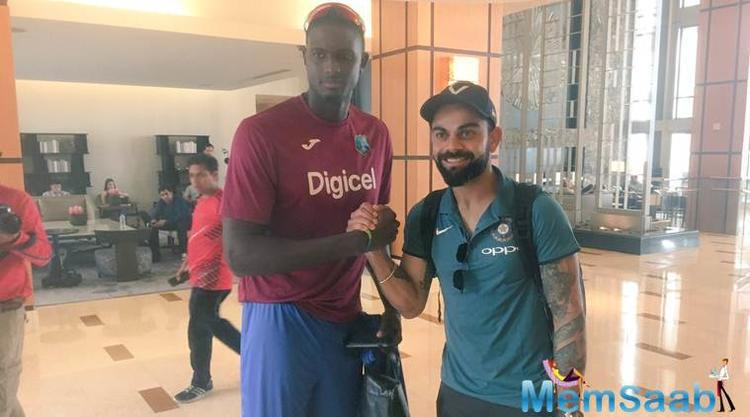 West Indies captain Jason Holder and his Indian counterpart Virat Kohli pose upon Team India's arrival in Port Of Spain on Wednesday.