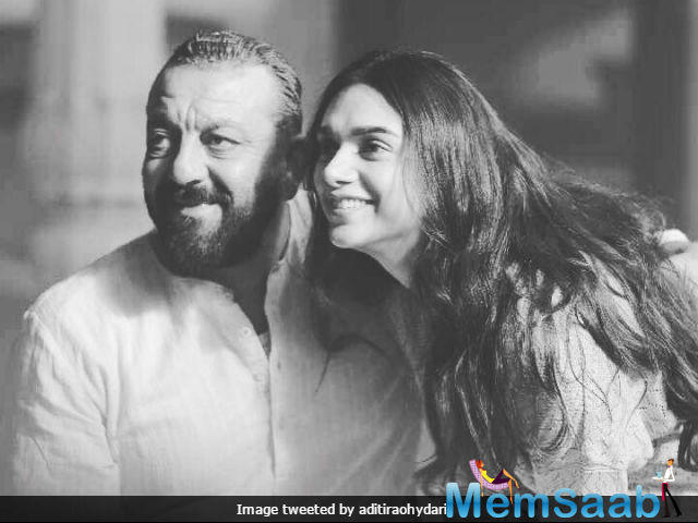 """The picture is taken on the shooting set of their forthcoming film Bhoomi, Aditi addressed Sanjay as an """"eternal rockstar""""."""