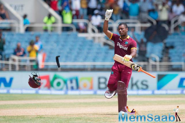 West Indies' Evin Lewis celebrates after he scored a century against India during a T20I at Sabina Park cricket ground in Kingston
