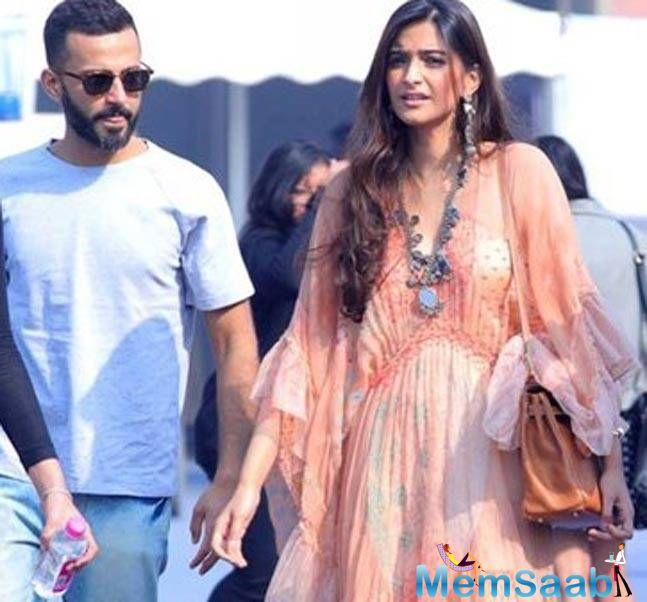 While Sonam gave a desi twist to her light blue and white checkered and layered outfit that she teamed with a funky neckpiece, Anand kept it cool in a summery outfit.