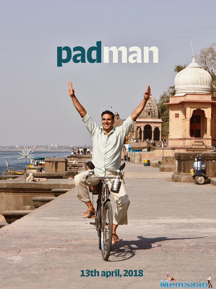 In the poster, the 'Rustom' star is caught riding a bicycle nonchalantly with his hands sprang up in ecstasy, alongside the ghats.