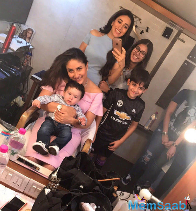 Karisma Kapoor also shared a photo with Bebo's cute son Taimur. The tiny tot was the surprise visitor on the sets!