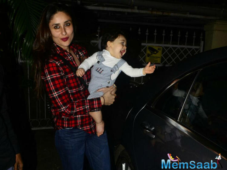 Kareena, wearing a red and black checkered shirt and jeans with a pair of knee-length boots, Kareena totally slayed it with her looks.
