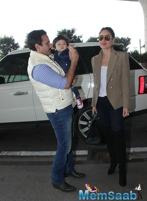While Bebo looked chic in her white tee, beige blazer and high-heel boots, Saif and baby Taimur twinned in blue and white checkered shirt, blue jeans and puffer jackets.