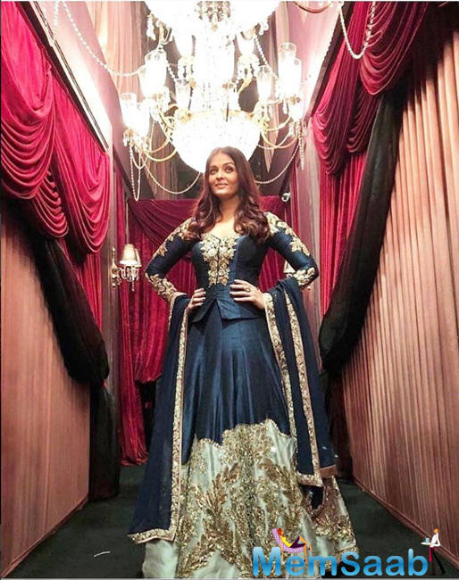 Recently at an event in Mumbai, the glam diva looked mesmerising a mid-night blue lehenga choli with golden embroidery detailing.