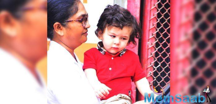 Looking his fashionable best, the toddler was spotted in a bright red tee that almost matched his rosy cheeks.