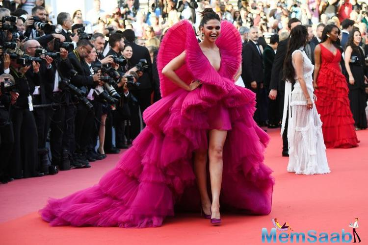 With hair tied in a bun and diamond earrings to go with it, Deepika not just flashed her million-watt smile, but also got goofy sticking her tongue out 'owning' the red carpet in style.