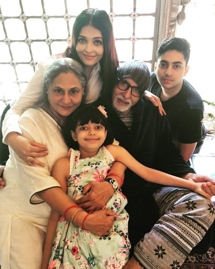 The couple's daughter-in-law Aishwarya Rai Bachchan also shared an adorable family portrait to wish the two.