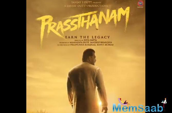 In the poster, Sanjay wears a white 'dhoti-kurta' and is walking in a farm against the background of a dimly-lit sky. The tagline of the film is 'Earn The Legacy'.