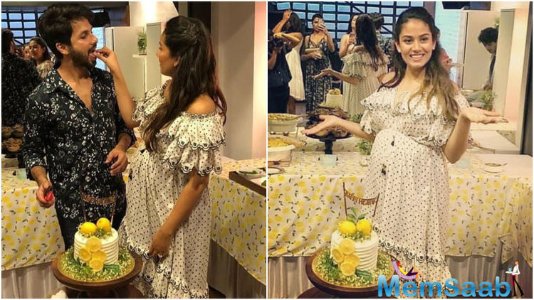 In a white off-shoulder polka dotted maxi dress, Mira looked chic as she cuts the cake and feeds it to husband Shahid.