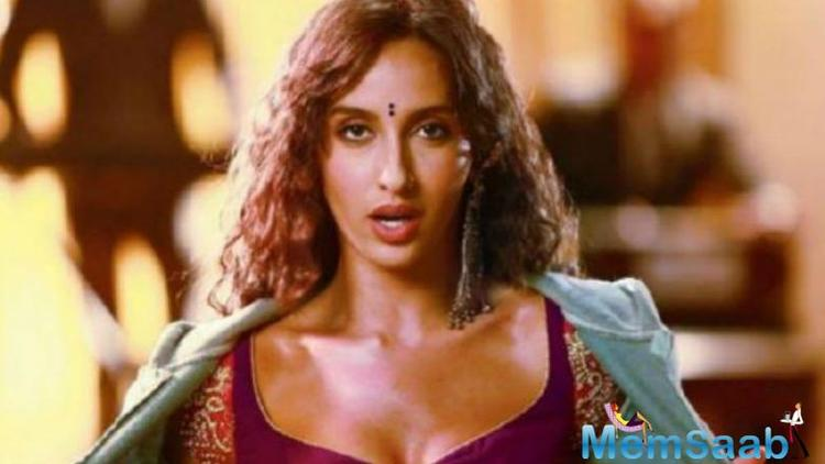In the still, shared as an Instagram story, Nora can be seen in a sultry avatar, donning a wine-shade blouse and grey jacket, a rather unusual combination. Fatehi's recent belly dancing videos on social media have earned her lot of appreciation.