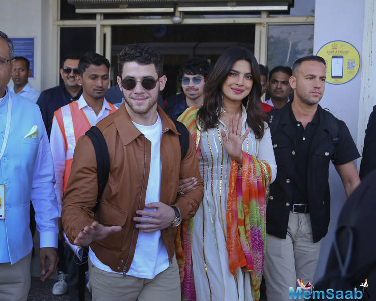 While Priyanka opted for a blue embellished suit for the occasion, beau Nick looked handsome in a pink and beige kurta pajama. Both of them added a twist to their desi avatars with edgy sunglasses.