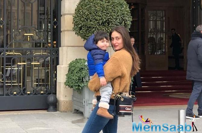 The little munchkin is miles away with momma Kareena and papa Saif in Paris. Post their holiday South African and London, and having fun in Switzerland, the fam is having a jam in Paris.