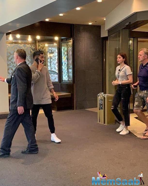 Fans are going gaga over the latest pictures and videos where the couple is seen entering a hotel, and they also seemed to be twinning in black pants and a shade of beige t-shirt.