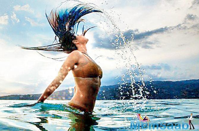 Mumbai's short-lived winter is over. Yesterday, Katrina Kaif set the mercury soaring by posting a bikini picture on Instagram. Kat is seen flipping her hair and flaunting her curves.