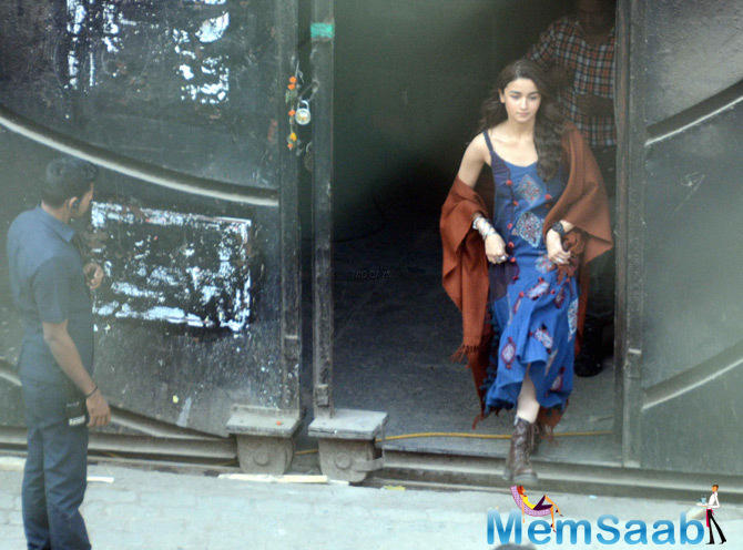 In the supposed look from her film, Alia could be seen wearing a blue spaghetti strap dress with a shawl wrapped around her and combat boots.
