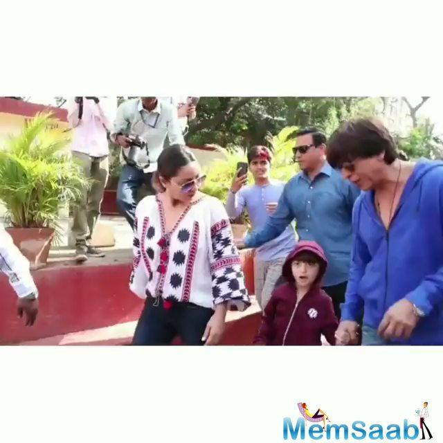 Bollywood superstar Shah Rukh Khan took his young son AbRam to a polling booth on Monday while casting his vote as the little one was confused between