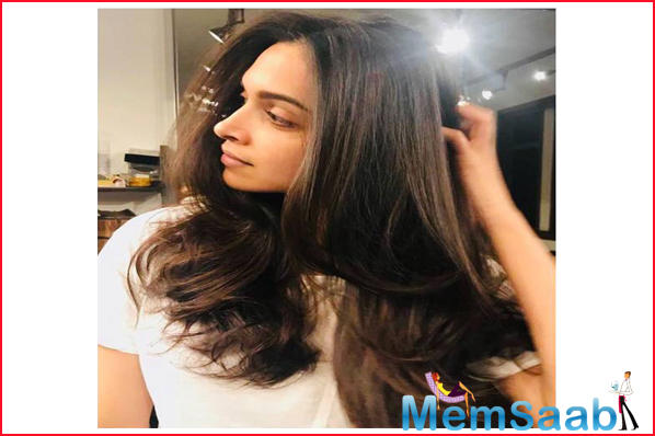 We cannot take our eyes off Deepika as she stuns with her lovely locks and a radiant skin.