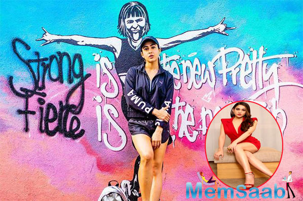 The graffiti also has a woman posing fiercely in between the words. More power to Sara!