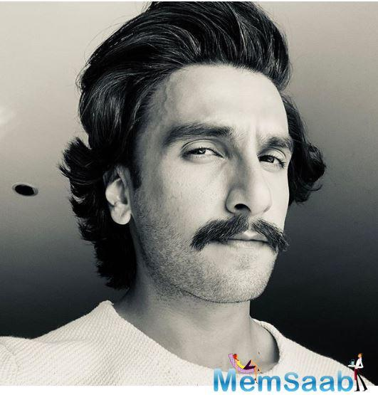 Ranveer Singh recently took to Instagram to share a black and white picture of himself looking all retro in a moustachioed look and a swept-back hairstyle.