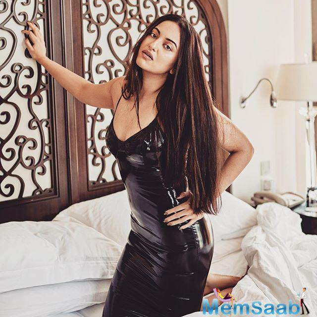 In the picture, Sonakshi is seen in black leather short dress. One just cannot miss her colored long hair which are enhancing her beauty.