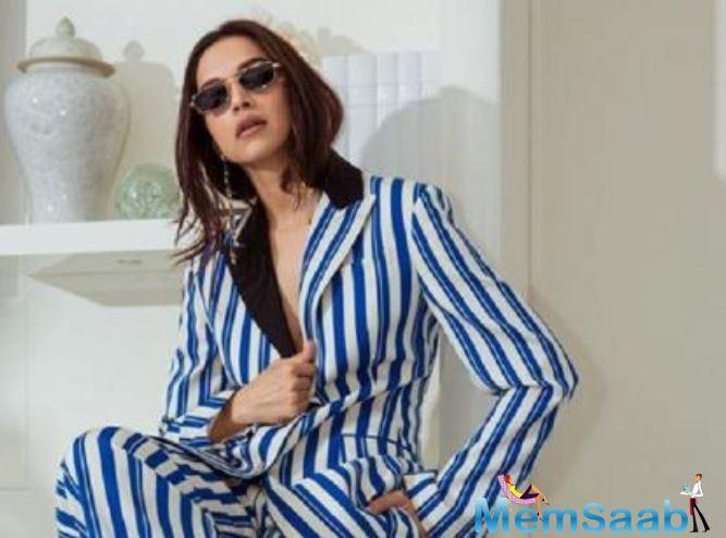 Padukone slays on Day 2 of Cannes Film Festival 2019 as she dons a striped pantsuit.