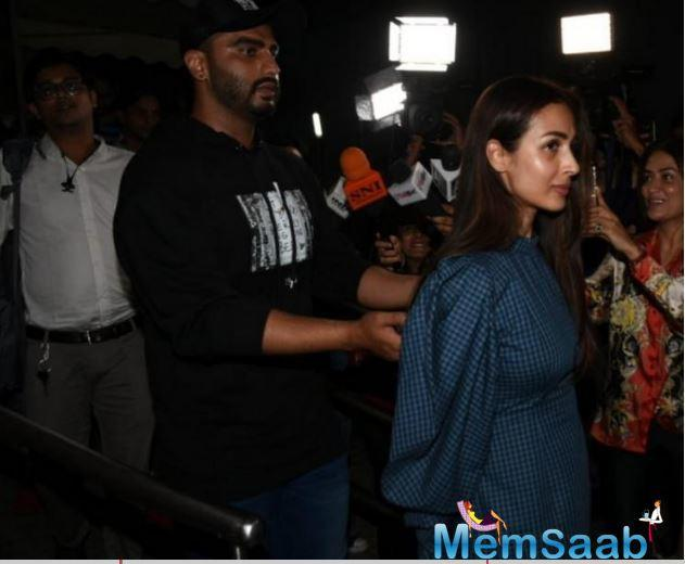While Malaika was spotted entering the screening alone, the paps spotted Malaika and Arjun making an exit together.