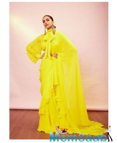 Deepika Padukone, who dazzled on the red carpet for Cannes 2019, has shared some stunning photos in a yellow ruffled sari.
