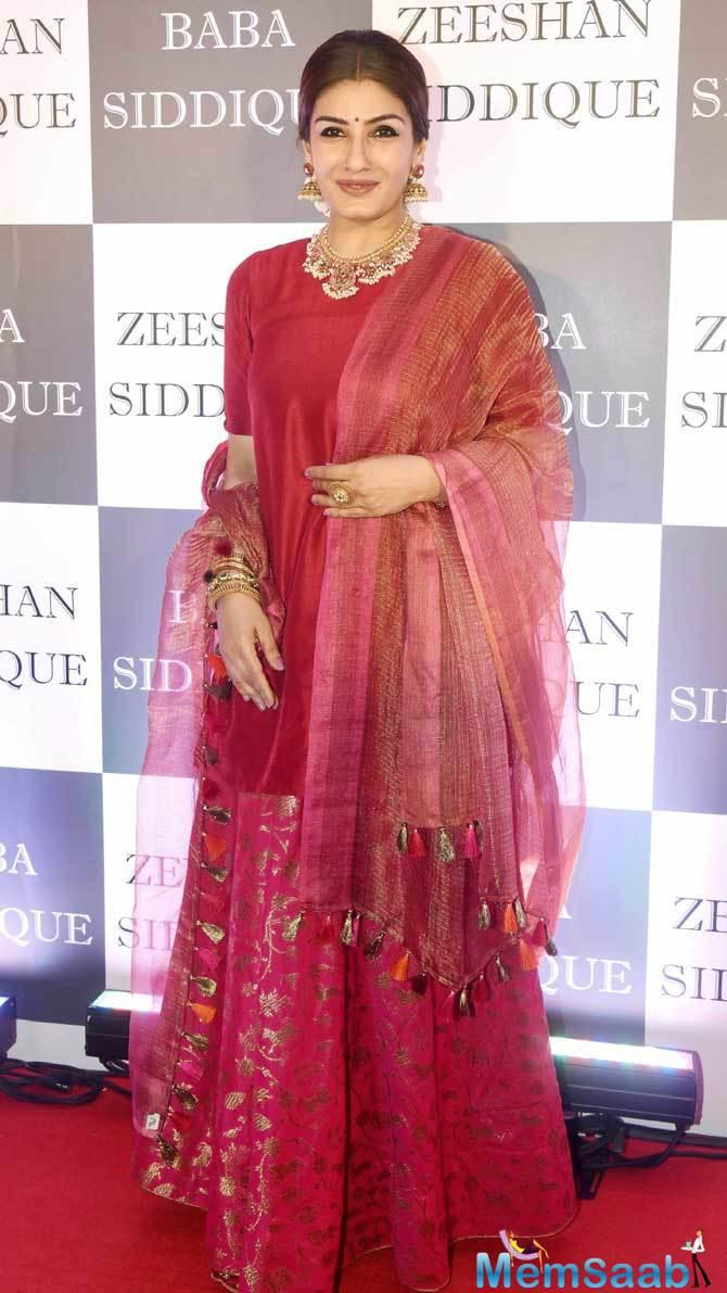 Raveena Tandon looked pretty as always in a red sharara set.