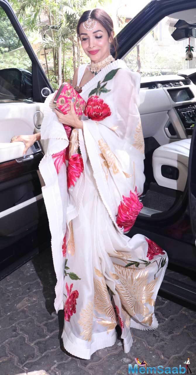 Malaika Arora arrived with filmmaker Karan Johar, she was sporting a traditional outfit.