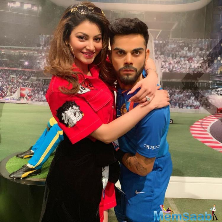 Urvashi Rautela has got mercilessly trolled for posting a picture where she is seen hugging the wax statue of the captain of Indian cricket team, Virat Kohli.