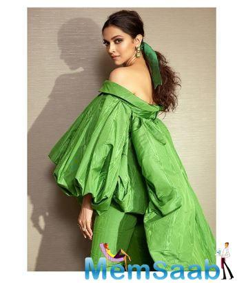 Deepika Padukone entered the red carpet wearing a green pantsuit. Deepika's green pantsuit is nothing but classy.