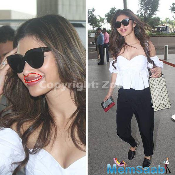 Coming back to her airport look, Mouni was seen flaunting a beautiful off-shoulder white top, paired with athleisure black pants.